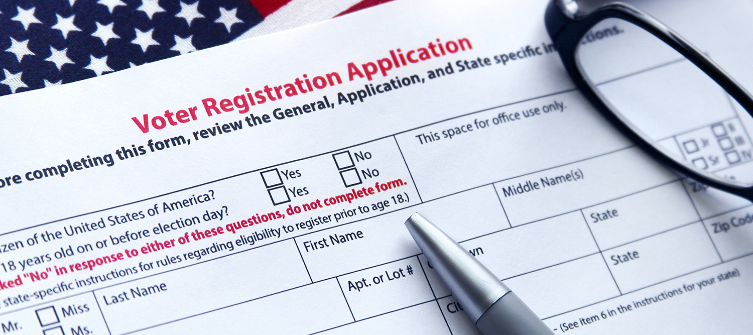 Image of voter registration form on a desk.