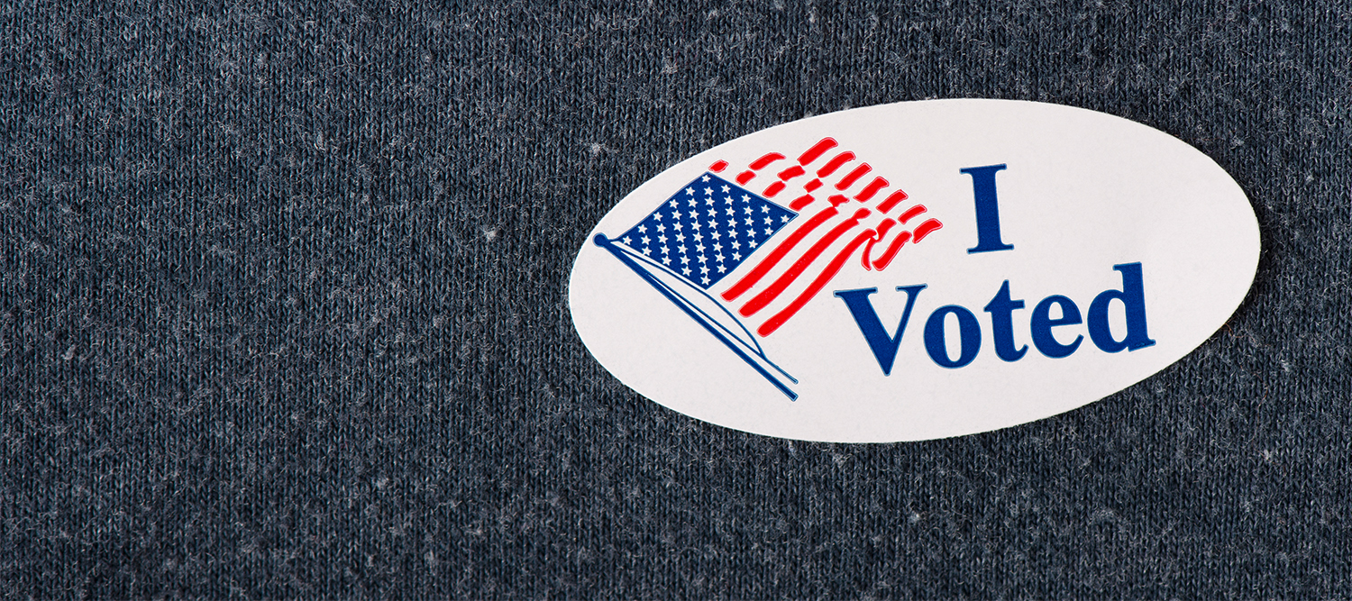 "image of an ""I voted"" sticker on a grey shirt."