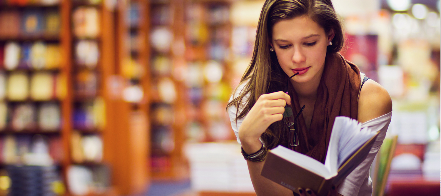 Teen Girl Reading with Glasses