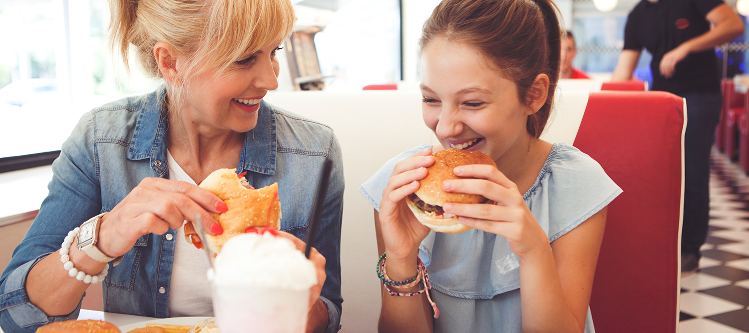 Girls with Mother Eating Hamburgers in Diner