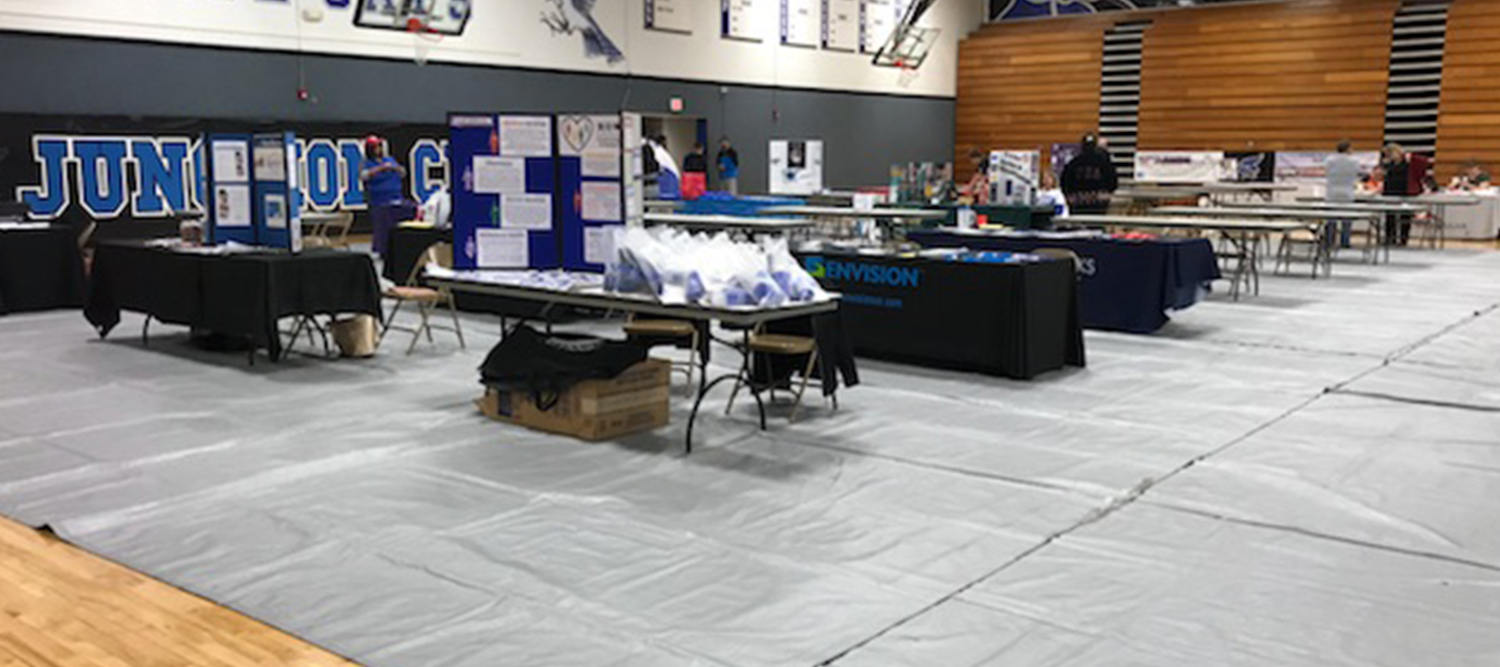 Photo of booths set up for the 2017 JCHS Family Resource Night in the gym.
